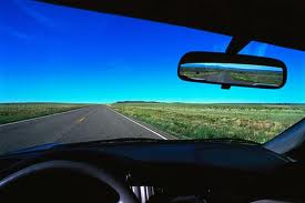 rear view mirror with the road ahead